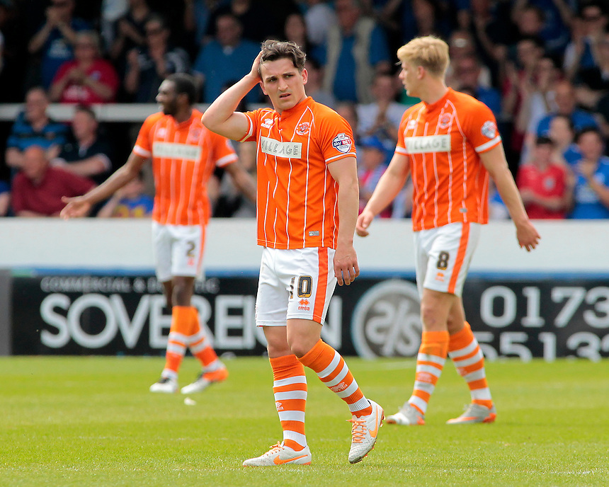 Blackpool's Jack Redshaw looks dejected as Peterborough United<br /> <br /> Photographer David Shipman/CameraSport<br /> <br /> Football - The Football League Sky Bet League One - Peterborough United v Blackpool  - Sunday 8th May 2016 - ABAX Stadium - London Road   <br /> <br /> &copy; CameraSport - 43 Linden Ave. Countesthorpe. Leicester. England. LE8 5PG - Tel: +44 (0) 116 277 4147 - admin@camerasport.com - www.camerasport.com