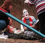 Bobo the clown, a.k.a. Jay Isenberg , comforts an accident victim as Leland (NC) Rescue Squad members arrive at an accident on NC 133 in Brunswick County (NC). Isenberg happened upon the accident and stayed with one of the injured women until rescue squad members arrived and transported them to New Hanover Regional Medical Center in Wilmington, NC. Photo by Jamie Moncrief