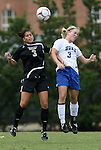 30 August 2009: Central Florida's Yvonne George (left) and Duke's Libby Jandl (right). The Duke University Blue Devils lost 3-2 to the University of Central Florida Knights at Fetzer Field in Chapel Hill, North Carolina in an NCAA Division I Women's college soccer game.