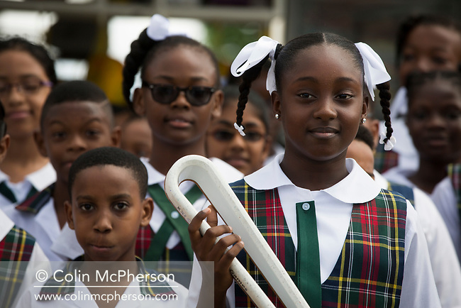 The Queen's Baton Relay spent the day in Georgetown the Capital City of Guyana and at nearby Essquibo on the first full day of a three-day visit to the country. This Queen's Baton Relay will visit all 70 nations and territories of the Commonwealth, over 388 days and cover 230,000km. It will be the longest Relay in Commonwealth Games history, finishing at the Opening Ceremony on the Gold Coast on 4th April 2018. Photograph shows pupils from Green Acres school connected with Coomera Springs State School, Queensland, with the Baton during a relay through the streets of Georgetown.