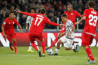 Calcio, Champions League: Gruppo D - Juventus vs Siviglia. Torino, Juventus Stadium, 30 settembre 2015. <br /> Juventus&rsquo; Paulo Dybala, second from right, is challenged by Sevilla's Marco Andreolli during the Group D Champions League football match between Juventus and Sevilla at Turin's Juventus Stadium, 30 September 2015. <br /> UPDATE IMAGES PRESS/Isabella Bonotto