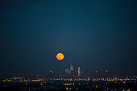 The super moon and the World Trade Center are seen from a state park in New Jersey, June 23, 2013, Photo by Eduardo Munoz Alvarez / VIEWpress.