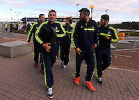 Wednesday 18 September 2013<br /> Pictured L-R FRONT: Angel Rangel, Jordi Amat and Alejandro Pozuelo about to enter Cardiff Airport. <br /> Re: Swansea City FC players and staff travelling to Spain for their UEFA Europa League game against Valencia.