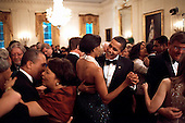 Washington, DC - February 22, 2009 -- United States President Barack Obama and First Lady Michelle Obama dance while the band Earth, Wind and Fire performs at the Governors Ball in the East Room of the White House, February 22, 2009. .Credit: Pete Souza - The White House via CNP