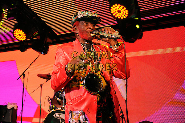 LONDON, ENGLAND - DECEMBER 1:   Lee 'Scratch' Perry performing at Under The Bridge on December 1, 2014 in London, England.<br /> CAP/MAR<br /> &copy; Martin Harris/Capital Pictures