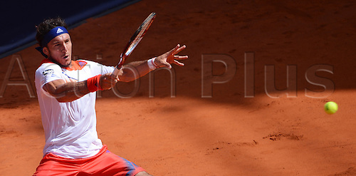 17.07.2013. Hamburg, Germany.  Argentina's Juan Monaco returns the ball during the second round match against France's Monfils during the 2013 International German Open at Am Rothenbaum inHamburg,Germany, 17July 2013.