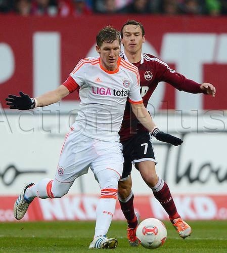 17.11.2012. Munich, Germany.  Bundesliga Season 2012 2013  FC Nuernberg versus FC Bayern  Munich. Bastian Schweinsteiger Munich challenges with Markus Feulner Nuernberg