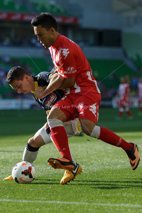 Storm ROUX of the Mariners and Iain RAMSAY of the Heart fight for the ball in the round two match between Melbourne Heart and the Central Coast Mariners in the Australian Hyundai A-League 2013-24 season at AAMI Park, Melbourne, Australia.<br /> This image is not for sale. Please visit zumapress.com for image licensing.