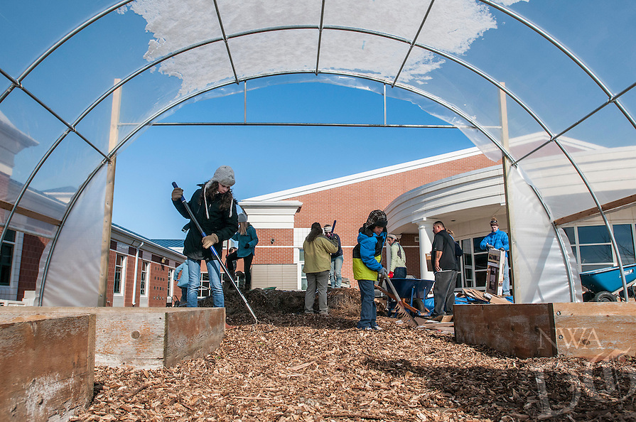 NWA Democrat-Gazette/ANTHONY REYES &bull; @NWATONYR<br /> Alondra Delgado, (left) 12, and her brother J.D. Delgado, 8, spread mulch with other volunteers Monday, Jan. 18, 2016 in a high tunnel at Bayyari Elementary School in Springdale. The volunteers, mostly from Food Corp. spend a portion of their day speeding mulch and building planting tables. The high tunnel was built with the help of University of Arkansas graduate students and should be completed by early February. The volunteers were also working Monday for the Martin Luther King Jr. Day of Service.