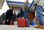 A long line of customers wait to buy Kerosene for their heaters, Monday, October 31, 2011,  at Dania Food Mart on West Street in Vernon.  The store owner, Mohammed Shoaib,  said he sold over 16,000 gallons of gasoline Sunday. Shoaib said he is staying open 24-hours a day until other stations open up and was expecting three tanker refuelings Monday.(Jim Michaud/Journal Inquirer)