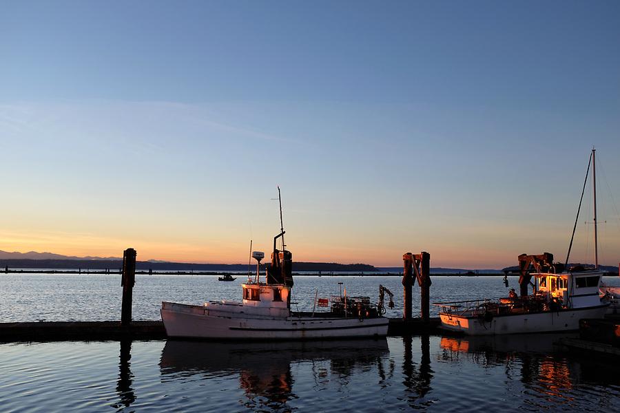 Boat at south public dock during sunset, Port of Everett Marina, Washington, USA