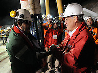 Rescue of miner's chiel Luis Urzua, the last miner to be rescued from the bottom of a tunnel in San Jose mine, where they spend 70 days traped. The rescue operation was a complete success with all the 33 miners alive back home. Signing national Chilean song with Urzua is President Sebastian Pinera.