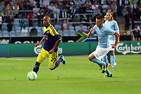 Thursday 08 August 2013<br /> Pictured: Jonathan de Guzman of Swansea closely followed by Erdal Rakip of Malmo. <br /> Re: Malmo FF v Swansea City FC, UEFA Europa League 3rd Qualifying Round, Second Leg, at the Swedbank Stadium, Malmo, Sweden.