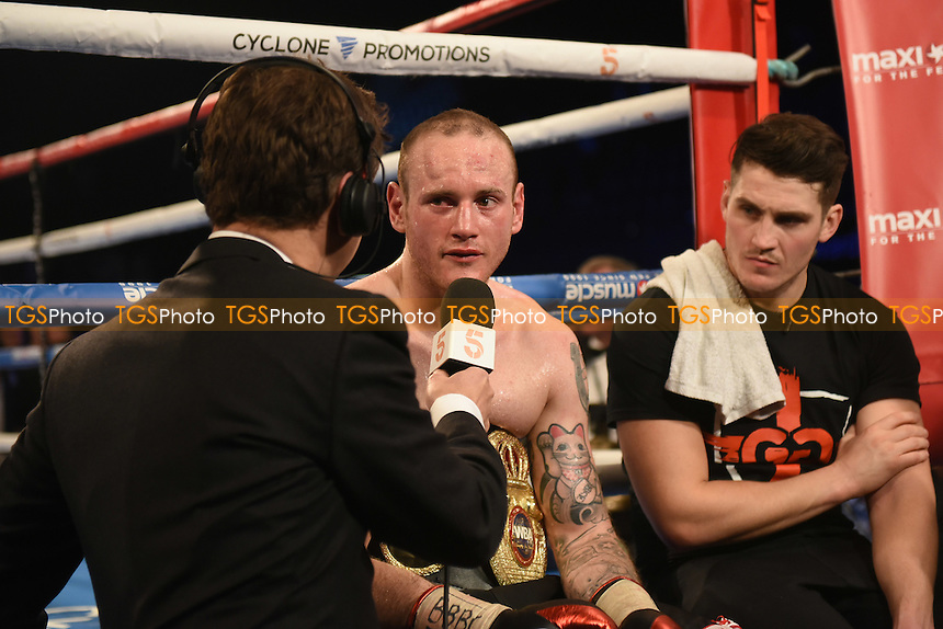 George Groves (black/white/red shorts) defeats Eduard Gutknecht during a boxing show at the SSE Arena, Wembley on 18th November 2016
