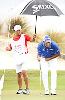 151206 Caddy Shindo San keeps Hidecki Matsuyama dry during Sunday's Final Round of the Hero World Challenge at The Albany Golf Club, in New Providence, Nassau, Bahamas.(photo credit : kenneth e. dennis/kendennisphoto.com)