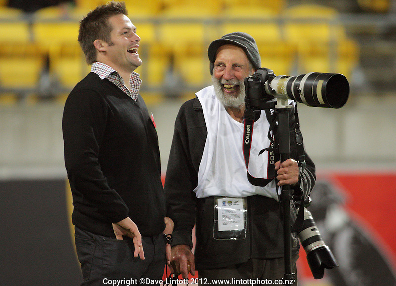 Injured All Blacks and Crusaders captain Richie McCaw chats with veteran photographer Peter Bush during the Super 15 rugby match between the Hurricanes and Crusaders at Westpac Stadium, Wellington, New Zealand on Saturday, 21 April 2012. Photo: Dave Lintott / lintottphoto.co.nz