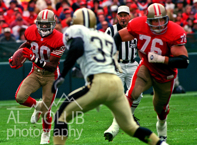 San Francisco 49ers vs. New Orleans Saints at Candlestick Park Sunday, October 29, 1995.  Saints beat 49ers  11-7.  San Francisco 49ers tackle Kirk Scrafford (76) blocks for wide receiver Jerry Rice (80).