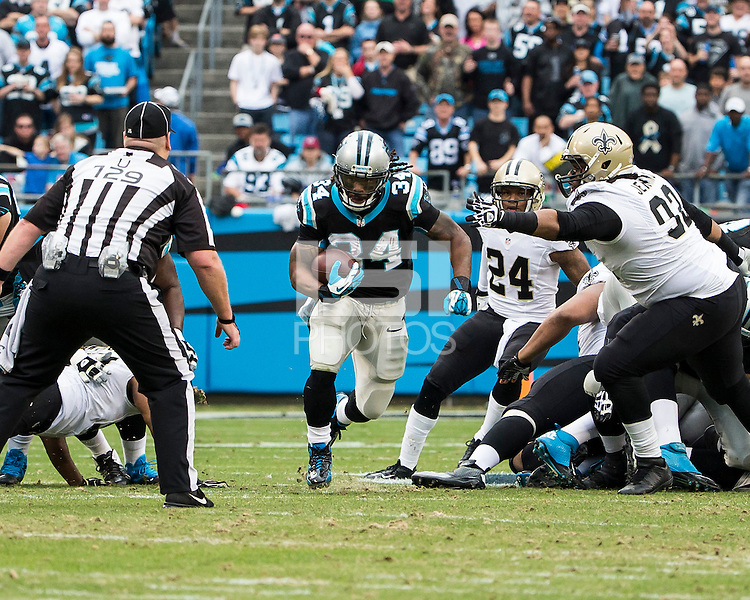 The Carolina Panthers played the New Orleans Saints for supremacy in the NFC South.  December 22, 2013 at Bank of America Stadium.  The Panthers scored the winning touchdown with 23 seconds left in the game to give them the opportunity to clinch the NFC South with a win next week.  Carolina Panthers running back DeAngelo Williams (34) cuts through a hole to score the Panthers first touchdown.