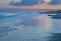 People enjoying the sunset along the shores of Emerald Isle in North Carolina