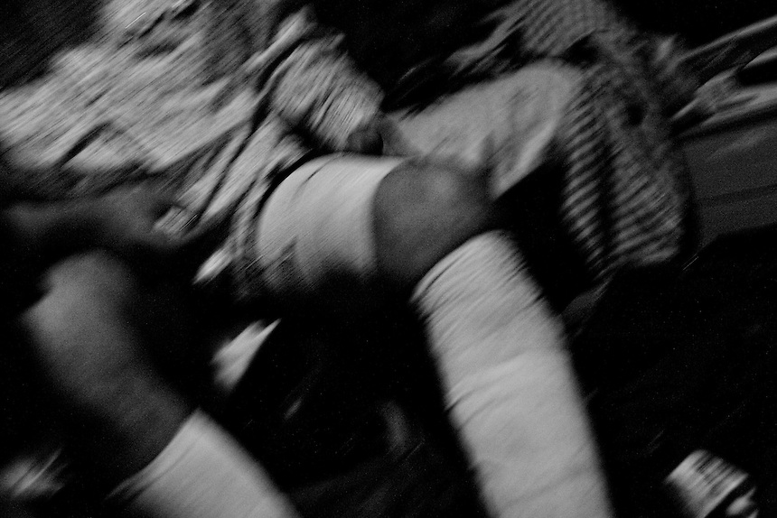 Jimmy 'Stretch' Borunda tries to keep the pain and swelling in his leg to a minimum after a bull's foot landed on him in Bastrop, Texas. August 2, 2008.