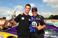 Apr. 29, 2012; Baytown, TX, USA: NHRA pro stock driver Vincent Nobile (left) celebrates with Jim Yates after winning the Spring Nationals at Royal Purple Raceway. Mandatory Credit: Mark J. Rebilas-