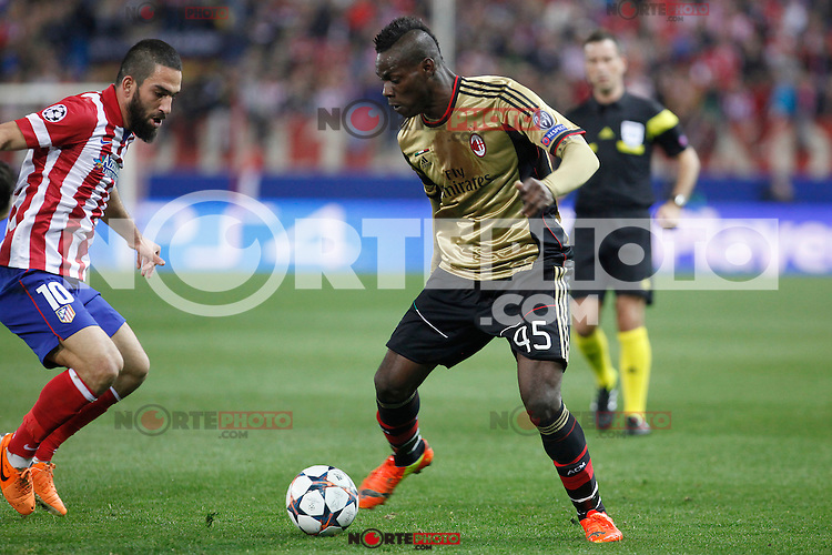 Atletico de Madrid´s Arda Turan (L) and Milan´s Balotelli during 16th Champions League soccer match at Vicente Calderon stadium in Madrid, Spain. January 06, 2014. (ALTERPHOTOS/Victor Blanco)