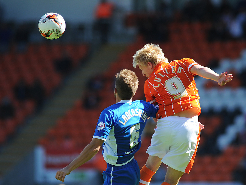 Blackpool's Mark Cullen wins a header against Rochdale's Oliver Lancashire<br /> <br /> Photographer Kevin Barnes/CameraSport<br /> <br /> Football - The Football League Sky Bet League One - Blackpool v Rochdale - Saturday 15th August 2015 - Bloomfield Road - Blackpool<br /> <br /> &copy; CameraSport - 43 Linden Ave. Countesthorpe. Leicester. England. LE8 5PG - Tel: +44 (0) 116 277 4147 - admin@camerasport.com - www.camerasport.com