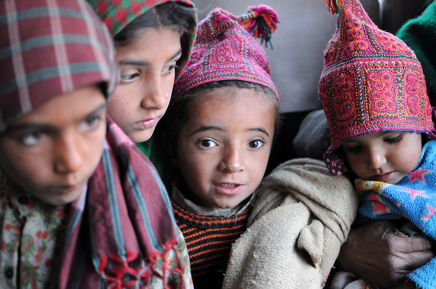 Van Gujjar kids, riding on a bus from one roadside camp to the next.