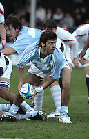 Argentina scrum half Martin Landajo gets his backline moving in this pool match against England.