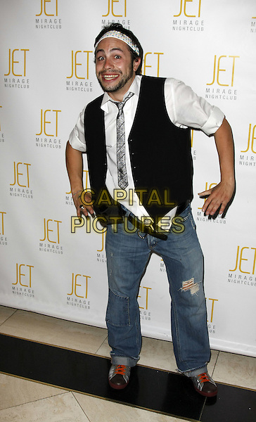 "DOMENICO NESCI.""That's Amore'"" Premiere Party held at Jet night club in the Mirage Hotel and Casino, Las Vegas, Nevada, USA, .14 March, 2008 .full length jeans hairband head band black waistcoat tie white shirt .CAP/ADM/MJT.©MJT/Admedia/Capital Pictures"