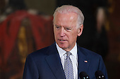 United States Vice President Joe Biden speaks during the an Easter Prayer Breakfast in the East Room of the White House with U.S. President Barack Obama, not pictured, in Washington, D.C., U.S., on Tuesday, April 7, 2015. Christian leaders from across the country join President Obama at the breakfast to pray and reflect on Holy Week and Easter. <br /> Credit: Andrew Harrer / Pool via CNP