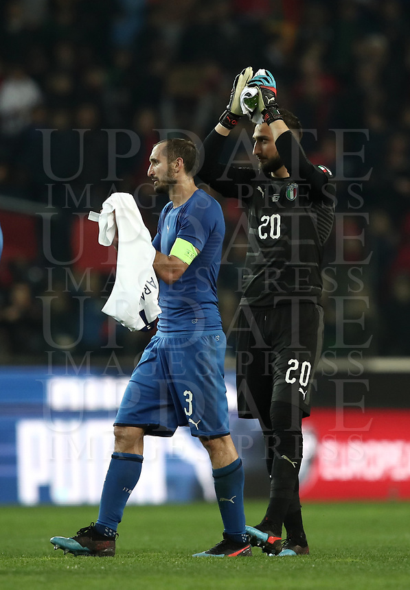Football: Euro 2020 Group J qualifying football match Italy vs Finland at the Friuli Stadium in Udine on march  23, 2019<br /> Italy's captain Giorgio Chiellini (l) and goalkeeper Gianluigi Donnarumma (r) celebrate after winning 2-0 the Euro 2020 qualifying football match between Italy and Finland at the Friuli Stadium in Udine, on march 23, 019<br /> UPDATE IMAGES PRESS/Isabella Bonotto