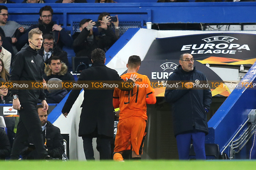Yevhen Khacheridi of PAOK Salonika heads to the dressing room after receiving a red card while Chelsea Manager, Maurizio Sarri, smokes his imaginary cigarette during Chelsea vs PAOK Salonika UEFA Europa League Football at Stamford Bridge on 29th November 2018