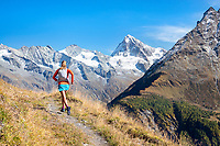 Running above Arolla and Evolène during the Via Valais, a multi-day trail running tour connecting Verbier with Zermatt, Switzerland.