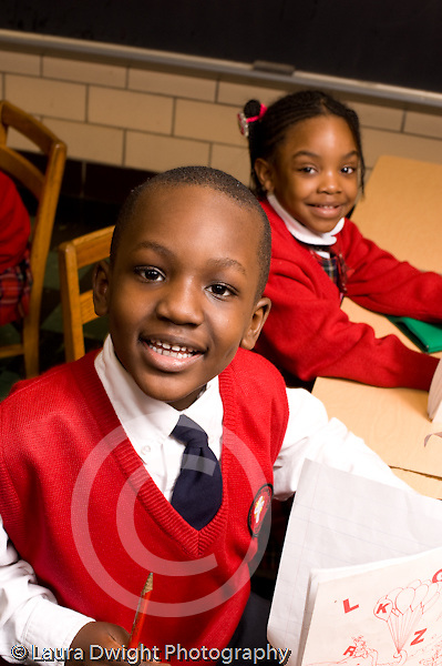 Parochial School Bronx New York  Kindergarten portrait of boy and girl smiling happy vertical