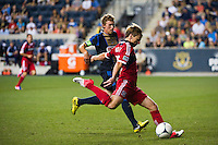 Chris Rolfe (18) of the Chicago Fire shoots and scores his second of the match. The Chicago Fire defeated the Philadelphia Union 3-1 during a Major League Soccer (MLS) match at PPL Park in Chester, PA, on August 12, 2012.