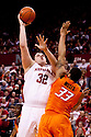 12 February 2011: Nebraska Cornhuskers center Andre Almeida #32 shoots over Oklahoma State Cowboys forward Marshall Moses #33 during the first half at the Devaney Sports Center in Lincoln, Nebraska. Nebraska defeated Oklahoma State 65 to 54.