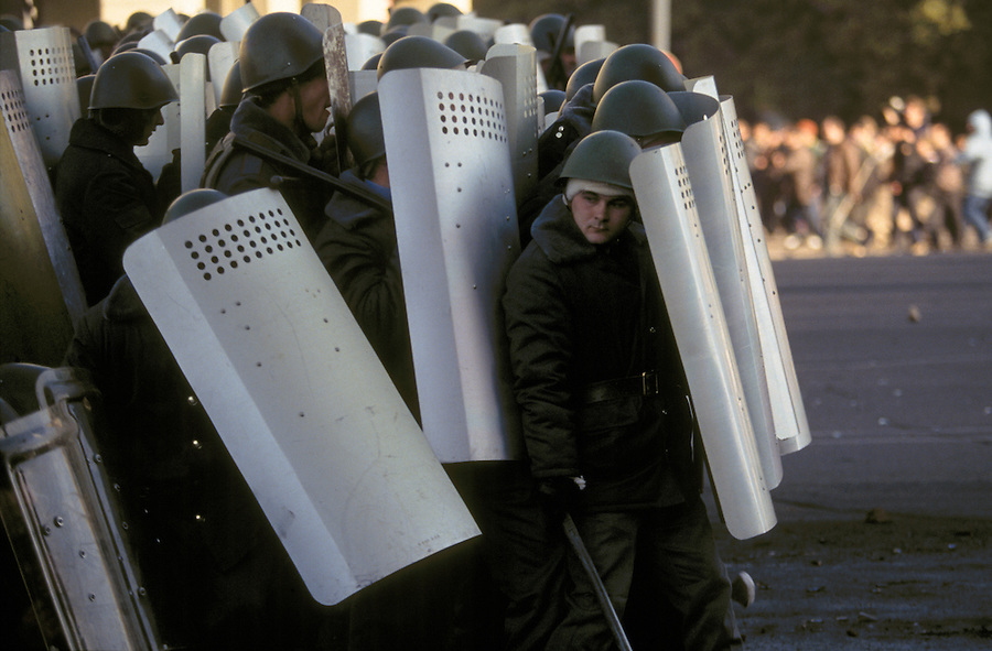 Moscow, Russia, 03/10/1993..Pro-Government militia retreat under attack from demonstrators trying to reach the Russian Parliament. When President Boris Yeltsin dissolved the opposition-dominated Russian Parliament,  deputies and supporters, led by Vice President Alexander Rutskoi, barricaded themselves inside the White House. After a 10 day stand-off the situation exploded into violence between pro and anti Yeltsin forces.