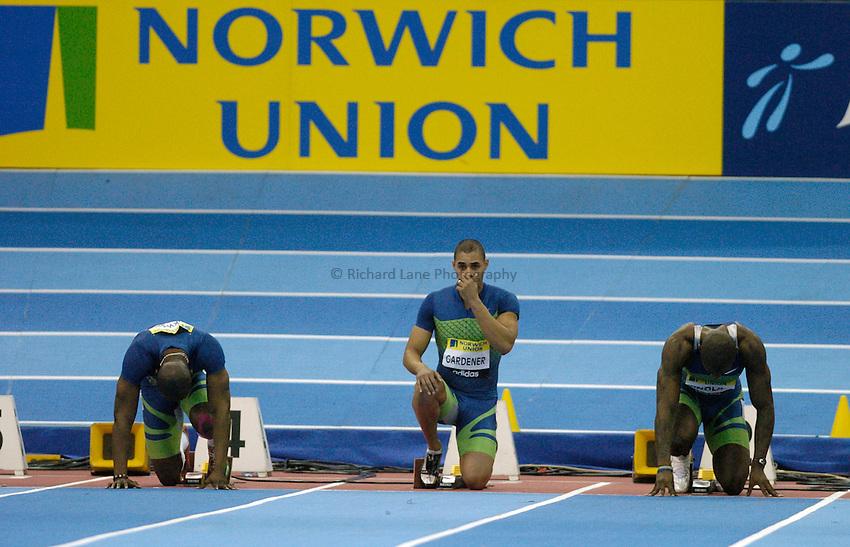 Photo: Richard Lane..Norwich Union Indoor Grand Prix, Birmingham. 17/02/2007. .Great Britain's Jason Gardener (c) prepares for a men's 60m heat.