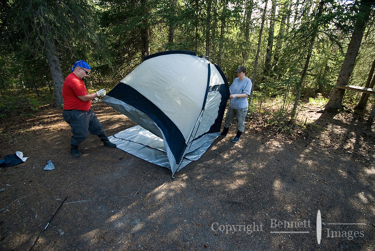 Nick Lynch and Kirsten Olsen set up their tent at a camp along the Kenai River.