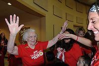 """NWA Democrat-Gazette/FLIP PUTTHOFF <br /> MARY MAE HERO<br /> Mary Mae Jones, 91, receives congratulations Friday Sept. 25 2015 from students and faculty at Mary Mae Jones Elementary in Bentonville after Jones was named the winner of the """"Share Your Hero"""" contest sponsored by Mrs. Fields brand cookies of Broomfield, Colo. The contest drew nominations from around the world, a company representative said at a school assembly in Jones' honor.  Jamie Gaston, school nurse, nominated Jones for the award. Jones began teaching in Dumas in 1943 at the age of 19. She moved to Bentonville in 1962 and did not fully retire from teaching until 2005. Students at the assembly received cupcakes distributed by employees of Mrs. Fields brands."""