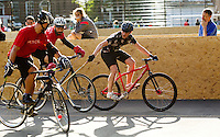 17 AUG 2014 - LONDON, GBR - A Triple Jay player (right) attempts to win control of the ball in a game against Mondial during the 2014 London Open bike polo tournament in Highbury Fields in London, Great Britain (PHOTO COPYRIGHT © 2014 NIGEL FARROW, ALL RIGHTS RESERVED)