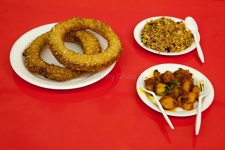 Dhaulagiri Kitchen, a tiny Nepalese restaurant in Jackson Heights. Pictured, sel roti, aloo dum, and sandheko wai wai.<br /> <br /> Danny Ghitis for The New York Times