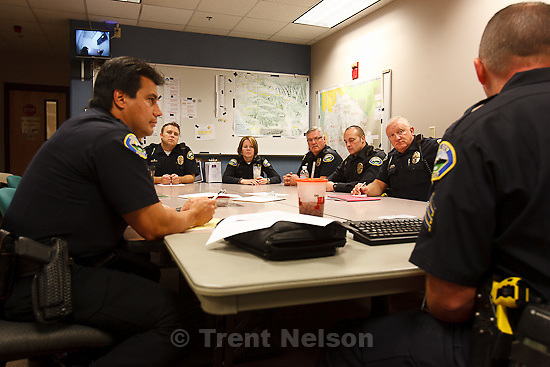 Trent Nelson  |  The Salt Lake Tribune.Sandy Police Department officers begin their shift with roll call on Wednesday, October 5, 2011 in Sandy, Utah.