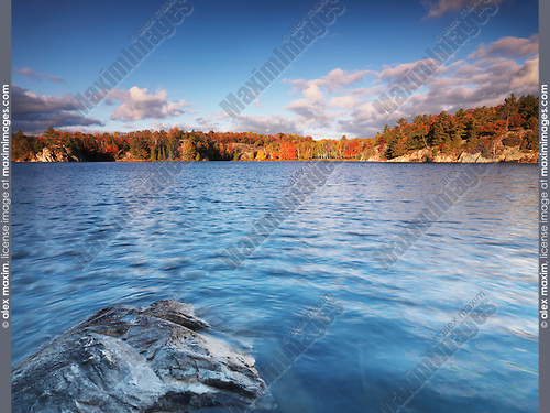 Fall landscape nature scenery of lake George during sunrise at Killarney provincial park, Ontario, Canada.