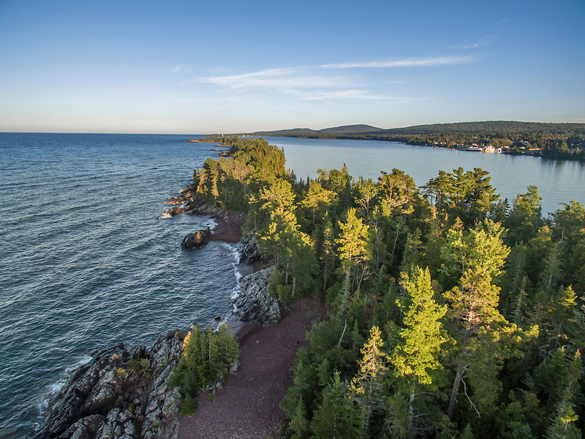Aerial drone image of Hunters Point barrier island on Lake Superior that creates the harbor at Copper Harbor, Michigan.