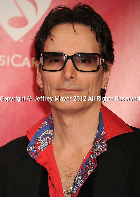 LOS ANGELES, CA - FEBRUARY 10: Steve Vai arrives at The 2012 MusiCares Person of The Year Gala Honoring Paul McCartney at Los Angeles Convention Center on February 10, 2012 in Los Angeles, California.