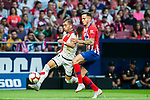 Adrian Embarba Blazquez, A Embarba (L), of Rayo Vallecano battles for the ball with Saul Niguez Esclapez of Atletico de Madrid during the La Liga 2018-19 match between Atletico de Madrid and Rayo Vallecano at Wanda Metropolitano on August 25 2018 in Madrid, Spain. Photo by Diego Souto / Power Sport Images