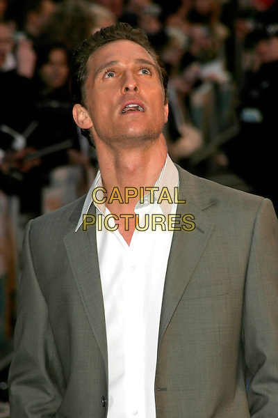 "MATTHEW McCONAUGHEY.""Fool's Gold"" UK film premiere, Vue Leicester Square, London, England..April 10th, 2008.half length grey gray suit jacket white shirt mouth open looking up .CAP/AH.©Adam Houghton/Capital Pictures."