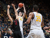 David Kravish of California shoots the ball during the game against Stanford at Haas Pavilion in Berkeley, California on February 5th, 2014.  Stanford defeated California, 80-69.